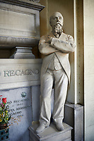 Picture and image of a stone sculpture of Giuseppe Recagno in a Borgeois Realistic style. The monumental tombs of the Staglieno Monumental Cemetery, Genoa, Italy
