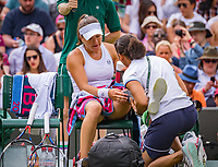 London, England, 4 th. July, 2018, Tennis,  Wimbledon, Womans singles second round, Alexandra Dulgheru (ROU) is treated for  an injury<br /> Photo: Henk Koster/tennisimages.com