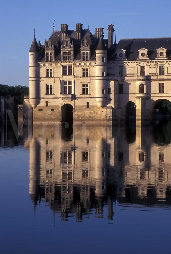 France, castle, Loire Valley, Chenonceau, Loire Castle Region, Indre-et-Loire, Europe, Reflection of 16th century Chateau de Chenonceau in the Cher River.