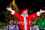 A delighted Santa turns on the Christmas tree lights during his visit to Causeway on Sunday.