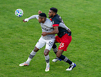 WASHINGTON, DC - NOVEMBER 8: Romell Quioto #30 of the Montreal Impact is defended by Donovan Pines #23 of D.C. United during a game between Montreal Impact and D.C. United at Audi Field on November 8, 2020 in Washington, DC.