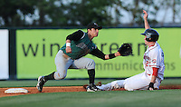 Second baseman Ryan Cavan (15) of the Augusta GreenJackets reaches for the throw as Jeremy Hazelbaker of the Greenville Drive slides in safely in a game on May 20, 2010, at Fluor Field at the West End in Greenville, S.C. Photo by: Tom Priddy/Four Seam Images