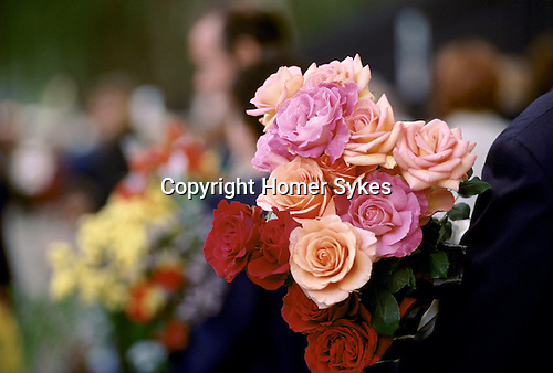 Chelsea Flower Show London. The last day, visitors at the end of the show are able to buy the specimens that have been in the show and are taking them home. 1990s