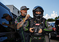 Jun 9, 2017; Englishtown , NJ, USA; NHRA funny car driver Alexis DeJoria (right) with husband Jesse James during qualifying for the Summernationals at Old Bridge Township Raceway Park. Mandatory Credit: Mark J. Rebilas-USA TODAY Sports