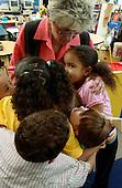 MR / Schenectady, NY.Yates Arts-in-Education Magnet School               .Full day pre-K class; urban public school               .State funding thru NYS Universal Pre-K Program.Teacher and students hug..MR: AE-pkf.©Ellen B. Senisi