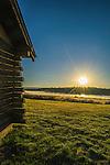 Log cabin at Harriman Ranch, Idaho at sunset.