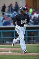 Henry Castillo (24) of the Visalia Rawhide runs to first base during a game against the Lancaster JetHawks at The Hanger on May 7, 2016 in Lancaster, California. Lancaster defeated Visalia, 19-5. (Larry Goren/Four Seam Images)