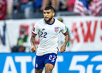 NASHVILLE, TN - SEPTEMBER 5: DeAndre Yedlin #22 of the United States looks to the ball during a game between Canada and USMNT at Nissan Stadium on September 5, 2021 in Nashville, Tennessee.
