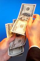 A businessman handing over $100 bills.