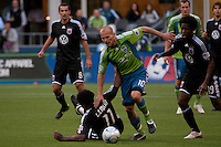 Seattle Sounders midfielder Freddie Lungberg (10) drives through Luciano Emilio (11) and Clyde Simms (19) of DC United in the match played on June 17, 2009 at Quest Field in Seattle, WA. The Sounders and United played to a 3-3 draw.