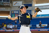 Michigan Wolverines batboy throwing before a game against Army West Point on February 17, 2018 at Tradition Field in St. Lucie, Florida.  Army defeated Michigan 4-3.  (Mike Janes/Four Seam Images)