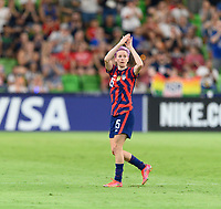 AUSTIN, TX - JUNE 16: Megan Rapinoe #15 of the United States applauds the fans as she is substituted out of the game late in the second half during a game between Nigeria and USWNT at Q2 Stadium on June 16, 2021 in Austin, Texas.