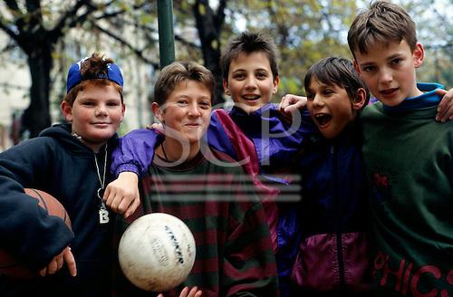 Sofia, Bulgaria. Five teenage boys with footballs.