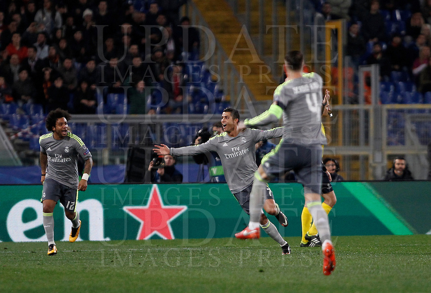 Calcio, andata degli ottavi di finale di Champions League: Roma vs Real Madrid. Roma, stadio Olimpico, 17 febbraio 2016.<br /> Real Madrid's Cristiano Ronaldo, center, celebrates with teammates Marcelo, left, and Sergio Ramos after scoring during the first leg round of 16 Champions League football match between Roma and Real Madrid, at Rome's Olympic stadium, 17 February 2016.<br /> UPDATE IMAGES PRESS/Isabella Bonotto