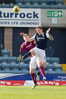 13th March 2021; Dens Park, Dundee, Scotland; Scottish Championship Football, Dundee FC versus Arbroath; Lee Ashcroft of Dundee competes in the air with Jack Hamilton of Arbroath