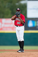 Hickory Crawdads starting pitcher Dillon Tate (38) looks to his catcher for the sign against the West Virginia Power at L.P. Frans Stadium on August 15, 2015 in Hickory, North Carolina.  The Power defeated the Crawdads 9-0.  (Brian Westerholt/Four Seam Images)