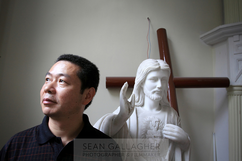 CHINA. Hangzhou. Father Bao Lu, in his church in central Hangzhou. During the Cultural Revolution, the church was used as a prison. 2009