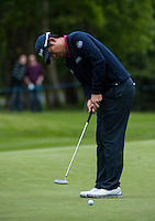 23.05.2015. Wentworth, England. BMW PGA Golf Championship. Round 3.  Byeong Hun An [KOR] putts on the 4th green, during the third round of the 2015 BMW PGA Championship from The West Course Wentworth Golf Club