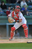 Catcher Austin Rei (13) of the Greenville Drive in a game against the Asheville Tourists on Thursday, April 7, 2016, at Fluor Field at the West End in Greenville, South Carolina. Greenville won, 4-3. (Tom Priddy/Four Seam Images)