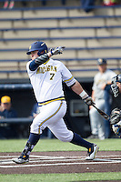 Michigan Wolverines catcher Harrison Wenson (7) follows through on his swing against the Toledo Rockets on April 20, 2016 at Ray Fisher Stadium in Ann Arbor, Michigan. Michigan defeated Bowling Green 2-1. (Andrew Woolley/Four Seam Images)