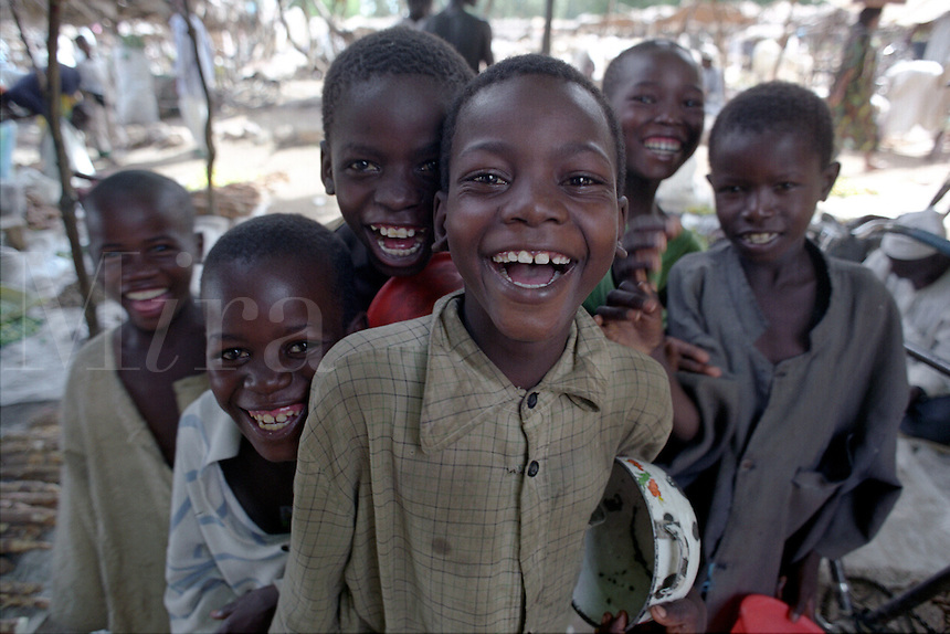 Laughing boys in marketplace. Mora, Extreme North, Cameroon, Africa.