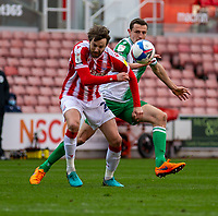 5th April 2021; Bet365 Stadium, Stoke, Staffordshire, England; English Football League Championship Football, Stoke City versus Millwall; Jed Wallace of Millwall puts Nick Powell of Stoke City under pressure