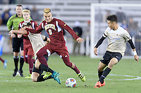Houston, TX - Friday December 9, 2016: Andre Shinyashiki (9) of the Denver Pioneers and Ian Harkes (16) of the Wake Forest Demon Deacons battle for control of the ball at the NCAA Men's Soccer Semifinals at BBVA Compass Stadium in Houston Texas.