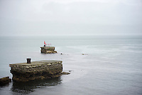 pink fisherman & his bike in the Irish sea next to the course<br /> <br /> Giro d'Italia 2014<br /> stage 2: Belfast-Belfast <br /> 219km