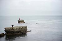 pink fisherman & his bike in the Irish sea next to the course<br /> <br /> Giro d'Italia 2014<br /> stage 2: Belfast-Belfast <br /> 219km