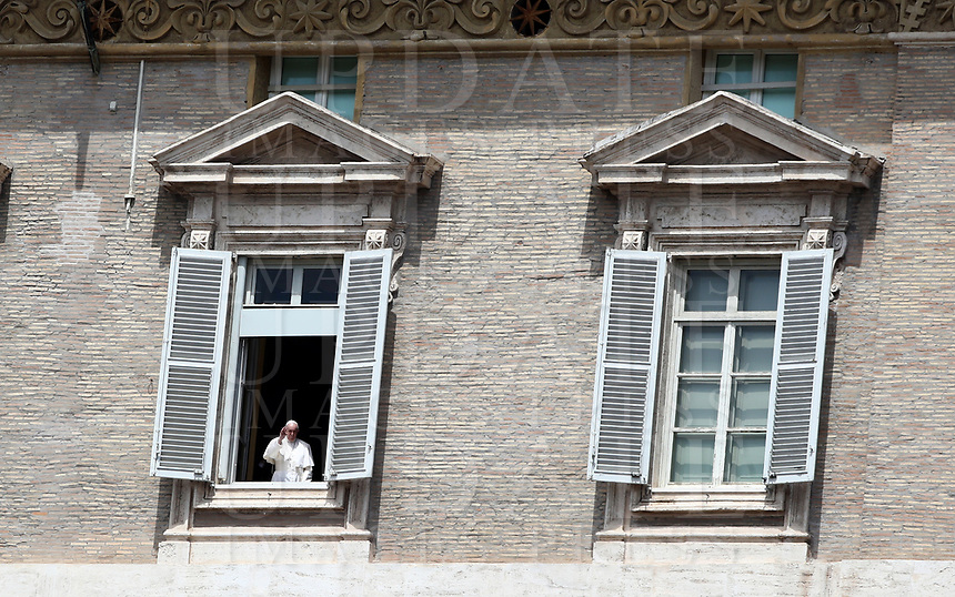 Pope Francis salutes from the window of the Apostolic Palace overlooking an empty St Peter' square, closed off to the public due to the novel coronavirus, COVID-19, pandemic, after his live-streamed Angelus prayer on May 10, 2020 at the Vatican. <br /> UPDATE IMAGES PRESS/Isabella Bonotto<br /> <br /> STRICTLY ONLY FOR EDITORIAL USE