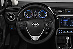 Car pictures of steering wheel view of a 2017 Toyota Corolla XLE Premium 4 Door Sedan