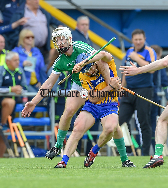Cian Lynch of Limerick in action against Podge Collins of Clare during their Munster championship game in Ennis. Photograph by John Kelly.