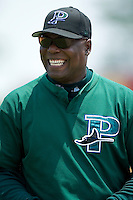 Princeton Devil Rays hitting coach Rafael Deleon shares a laugh between innings of their game versus the Burlington Indians at Burlington Athletic Park in Burlington, NC, Wednesday, July 19, 2006.