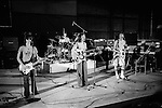 """Jimmy McCulloch Denny Laine  Joe English on drums, Paul, Linda Paul and Linda McCartney Wings Tour 1975.Elstree Studios rehearsal. The photographs from this set were taken in 1975. I was on tour with them for a children's """"Fact Book"""". This book was called, The Facts about a Pop Group Featuring Wings. Introduced by Paul McCartney, published by G.Whizzard. They had recently recorded albums, Wildlife, Red Rose Speedway, Band on the Run and Venus and Mars. I believe it was the English leg of Wings Over the World tour. But as I recall they were promoting,  Band on the Run and Venus and Mars in particular."""