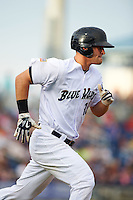 Pensacola Blue Wahoos first baseman Kyle Waldrop (15) runs to first during the second game of a double header against the Biloxi Shuckers on April 26, 2015 at Pensacola Bayfront Stadium in Pensacola, Florida.  Pensacola defeated Biloxi 2-1.  (Mike Janes/Four Seam Images)