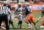 Boston College Eagles offensive lineman Harris Williams (64) blocks nose tackle Eric Crume (52) during a game against the Syracuse Orange at the Carrier Dome on November 30, 2013 in Syracuse, New York.  Syracuse defeated Boston College 34-31.  (Copyright Mike Janes Photography)