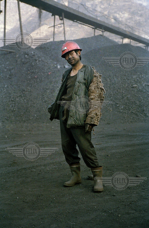 Worker in a small coal mine.  Shanxi is the largest producer of coal in China.  The rate of coal mining in the country is increasing from an annual production of over 2 billion tons in order to cater for China's rapid economic growth.