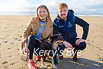 Dylan Burke and Michelle Daly with Sally the dog enjoying a stroll on Banna beach on New Years Day.
