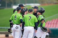 Kane County Cougars pitching coach Mike Parrot gathers with starting pitcher Justin Lewis (32), Blaze Alexander (5), Buddy Kennedy (7), and Jose Herrera (10) during a Midwest League game against the Cedar Rapids Kernels at Northwestern Medicine Field on April 28, 2019 in Geneva, Illinois. Cedar Rapids defeated Kane County 3-2 in game two of a doubleheader. (Zachary Lucy/Four Seam Images)