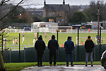 Bradford Park Avenue fans outside Horsfall Stadium watching through the fence, as their team lose 1-2 to Telford United in the National League North, 21st November 2020. The match was played behind closed doors, due to the second Coronavirus lockdown.