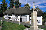 United Kingdom, England, Hampshire, Wherwell: Traditional thatched cottages in village square