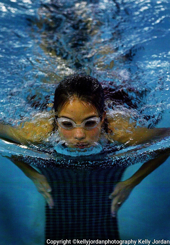 Seabreeze High School student and lifeguard Randi Bush-Burman, 17, glides through the water breaking the smooth surface as she takes practice laps at the Daytona Beach Community College pool Wednesday January 15, 2003.(Kelly Jordan)..**FOR STAND ALONE FEECH**