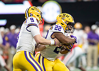 ATLANTA, GA - DECEMBER 7: Joe Burrow #9 of the LSU Tigers hands the ball of to Clyde Edwards-Helaire #22 during a game between Georgia Bulldogs and LSU Tigers at Mercedes Benz Stadium on December 7, 2019 in Atlanta, Georgia.