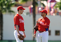 February 14, 2011; Clearwater, FL, USA; Philadelphia Phillies pitcher Cliff Lee (left) talks with pitcher J.C. Romero during spring training at Bright House Networks Field. Mandatory Credit: Mark J. Rebilas-