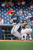 New Orleans Baby Cakes left fielder Destin Hood (1) follows through on a swing in front of catcher Bruce Maxwell (36) during a game against the Nashville Sounds on April 30, 2017 at First Tennessee Park in Nashville, Tennessee.  The game was postponed due to inclement weather in the fourth inning.  (Mike Janes/Four Seam Images)
