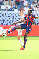 KANSAS CITY, KS - JULY 18: Gyasi Zardes #9 of the United States ,Alistair Johnson #2 of Canada during a game between Canada and USMNT at Children's Mercy Park on July 18, 2021 in Kansas City, Kansas.