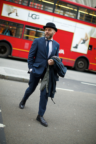 A man with a bowler hat