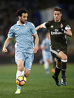 Calcio, Serie A: Lazio, Stadio Olimpico, 13 febbraio 2017.<br /> Lazio's MarcoParolo (l) in action with Milan's Mario Pasalic (r) during the Italian Serie A football match between Lazio and Milan at Roma's Olympic Stadium, on February 13, 2017.<br /> UPDATE IMAGES PRESS/Isabella Bonotto