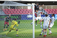 WASHINGTON, DC - NOVEMBER 8: Donovan Pines #23 of D.C. United heads the ball against Clement Diop #23 of Montreal Impact during a game between Montreal Impact and D.C. United at Audi Field on November 8, 2020 in Washington, DC.