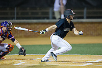 Nate Mondou (10) of the Wake Forest Demon Deacons follows through on his swing against the Clemson Tigers at David F. Couch Ballpark on March 12, 2016 in Winston-Salem, North Carolina.  The Tigers defeated the Demon Deacons 6-5.  (Brian Westerholt/Four Seam Images)
